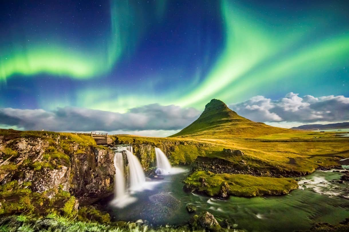 Aurora over Kirkjufell and waterfall at night