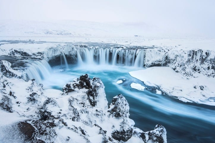 Beautiful winter Godafoss waterfall in Iceland, covered in snow,